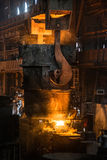 Steelworker near the tanks with hot metal. Steelworker near the tanks with hot steel Stock Images