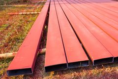 Steelworks sprayed in red with spray gun on the ground Stock Images