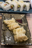 Steemed and slightly fried Gyoza (ravioli) with meet filling inside Royalty Free Stock Images
