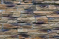Steen bruine textuur van een deel van de de bouwmuur Stock Afbeeldingen