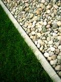 Steen en gras Stock Afbeelding