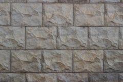 Steen grijze muur van geweven stenen voor de achtergrond stock afbeeldingen