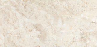 Steen marmeren achtergrond Marfil Crema stock afbeeldingen