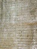 Steen met oude teksten Stock Afbeeldingen