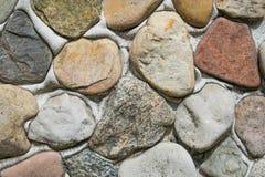 Steenachtergrond op de muur Stock Foto