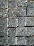 Steenbaksteen Textuurbakstenen muur, Close-up brickly grijze tegels De textuurachtergrond van de straatsteen royalty-vrije stock foto