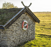 Steenhuis met reddingsboei Royalty-vrije Stock Fotografie
