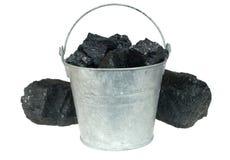 Steenkool in emmer Royalty-vrije Stock Afbeeldingen