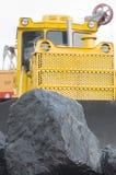 Steenkool en bulldozer Stock Fotografie