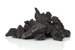 Steenkool op wit royalty-vrije stock afbeelding