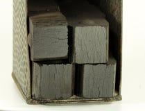 Steenkoolbriketten in oude drager Stock Afbeelding