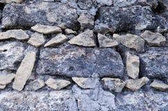 Steenmuur, kleine stenen die vierkante bakstenen vormen royalty-vrije stock afbeelding