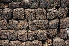Steenmuur van vulkanische puimrots die wordt gemaakt Stock Foto