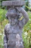 Steenstandbeeld van een kind - Portmerion-Dorp in Wales stock afbeelding