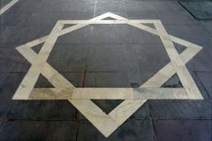 Steenvloer met octagram The Star van Lakshmi stock afbeelding