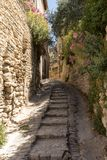 Steep alley with medieval houses in Gordes. Provence, royalty free stock photos