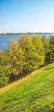 On the steep Bank. Autumn alley on the banks of the Volga river in Yaroslavl. Clear and Sunny day Royalty Free Stock Photo