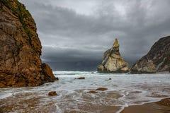 Praia da Ursa under the storm. Steep beach under the stormy clouds Stock Photo
