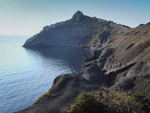Steep beautiful mountains and azure waters of the Black Sea off the coast of the village of Novy Svet royalty free stock photos