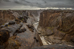 Steep canyon in stormy conditions Royalty Free Stock Photo