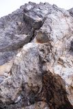 Steep cliff for climbing. Steep cliff with a climbing route royalty free stock photos