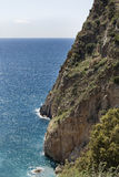 Steep cliff descending to sea Stock Photography