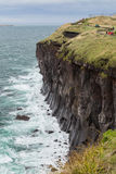 Steep cliff next to Songaksan Mountain on Jeju Island Stock Photography