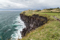 Steep cliff next to Songaksan Mountain on Jeju Island Stock Images