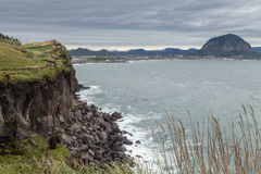 Steep cliff next to Songaksan Mountain on Jeju Island Royalty Free Stock Photos