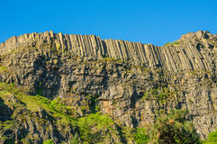 Steep cliff with organ pipe lava Royalty Free Stock Photos