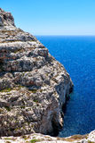 Steep cliff over Mediterranean sea on south of Malta island Royalty Free Stock Photo