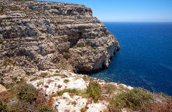 Steep cliff over Mediterranean sea on south of Malta island Royalty Free Stock Image