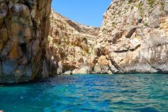 Steep cliff over Mediterranean sea on south part of Malta island. Near Blue Grotto Stock Photos