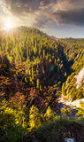 Steep cliff in romanian mountains at sunset Royalty Free Stock Images