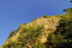 Steep cliff skyline over blue sky Royalty Free Stock Photo