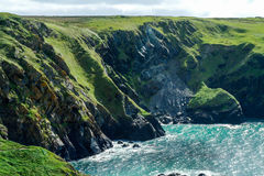 Steep cliffs around Mullion Cove, Cornwall. Showing coastal erosion Royalty Free Stock Photos