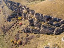 Steep cliffs of the Berezovsky Gorge on the outskirts of the city of Kislovodsk, Russia. A bird`s eye view on a sunny autumn day.  royalty free stock image