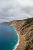 Steep cliffs and lonely beach Stock Photos