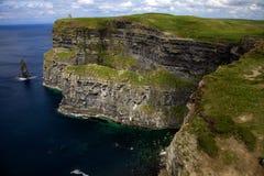 Steep Cliffs with Ocean Far Below. A wide vista of the Cliffs of Moher Stock Photos