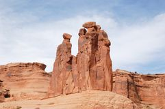 Rock Formations at Arches National Park. Steep cliffs of red rocks at Arches National Park in Utah, USA. Summer day setting Stock Image