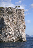 Steep cliffs rising from the sea Stock Photos