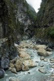 Steep cliffs & river at the Taroko National Park in Taiwan. Steep cliffs, deep gorge and rocky river at Swallow Grotto (Yanzikou) at the Taroko National Park in Royalty Free Stock Photography