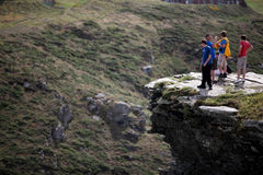 Steep Cliffs of Tintagel Castle in Cornwall. Tintagel Castle is a medieval fortification on the peninsula of Tintagel Island next to Tintagel village in Cornwall Stock Photo