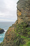 Steep cliffs with tiny figure Stock Photography