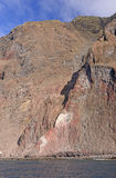 Steep Cliffs on a Volcanic Island Stock Photo