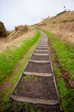 Steep Climb. Very steep steps leading to houses at top of hill in Auchmithie fishing village, Scotland Stock Photo