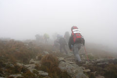 Steep climb the mountain in fog. The rise of the mountain in fog Royalty Free Stock Images