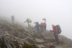 Steep climb the mountain in fog. The rise of the mountain in fog Royalty Free Stock Photography