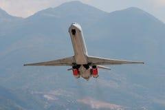 Steep climbing. Jet airplane climbing into the sky Stock Photos