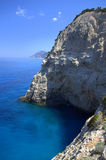 Steep coast and blue water Stock Photo